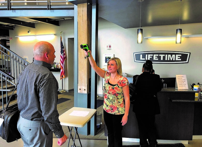 Businesses balance staying open, keeping workers healthy